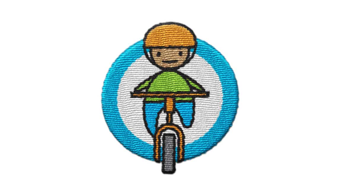 Trimtag Be Alert bike rider woven patch reflects light and enhances cyclist visibility