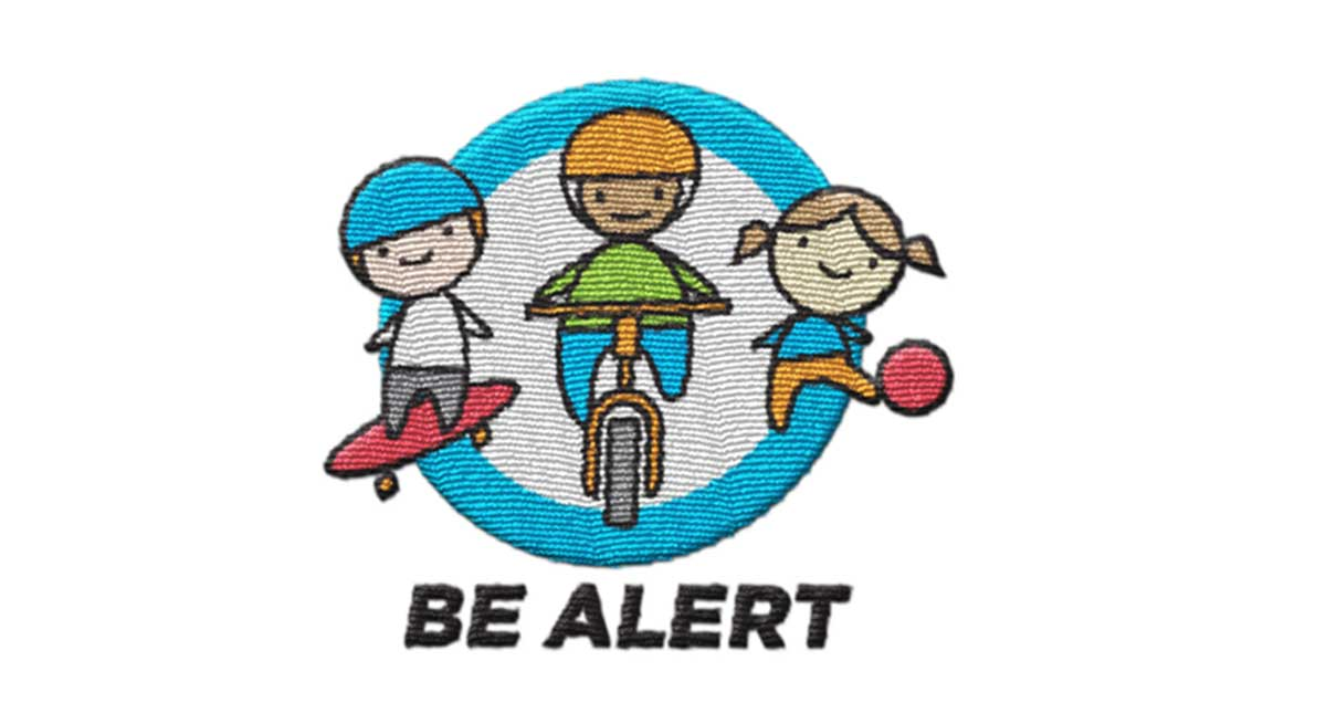 Trimtag BE ALERT road safety reflective products for school age children and prioritizes pedestrian and cycling safety