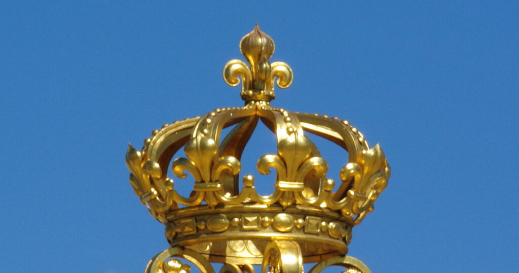 Gilded crown atop the reconstructed Gate of Honour at the Chateau de Versailles