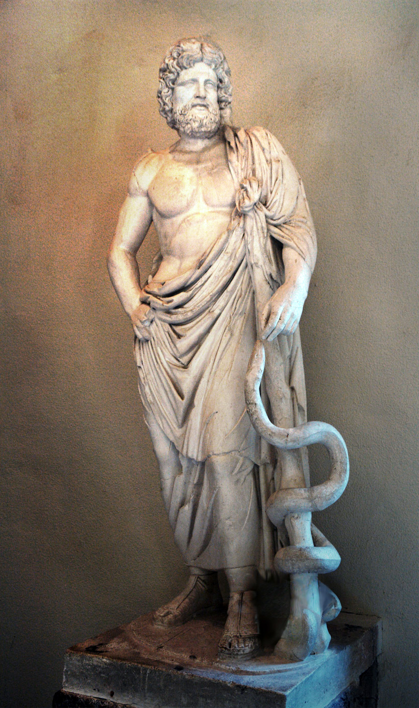 Statue of the Greek god of healing holds the Rod of Asclepius. Photo by Michael F. Mehnert, Museum of Epidaurus Theatre