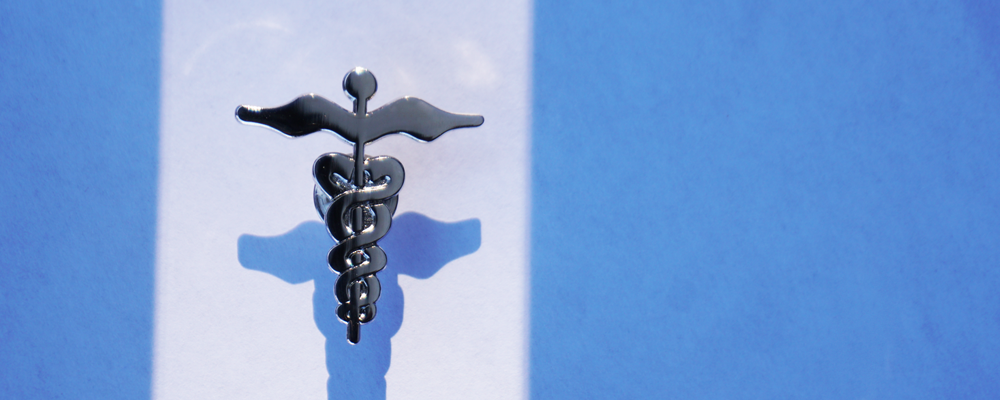 Healing Symbols caduceus lapel pin ©Trimtag Trading Inc
