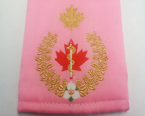 EMS pink epaulette with the healing symbol with a single snake known as the Rod of Asclepius