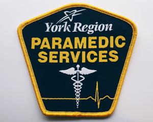 Caduceus healing symbol on York Region Paramedic Services shoulder patch