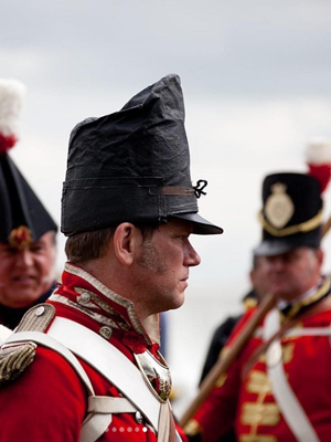 Replica military hat a peaked shako cap of the33rdfoot reenactment group like that worn by British 33rd Regiment of Foot infantry at the Battle of Waterloo